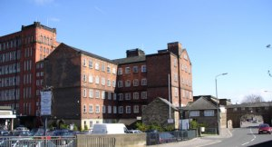 Jedediah Strutt's North Mill with the East Mill behind by Chevin